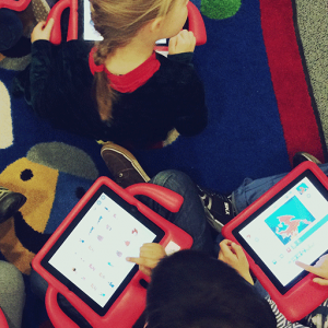 elementary school children learning how to code with scratchjr