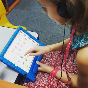 scratchjr app teaching a young student how to code